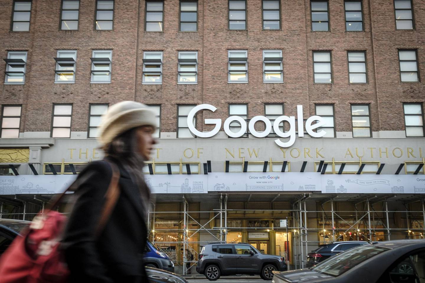 A pedestrian passes in front of Google headquarters in the Chelsea neighborhood of New York, U.S., on Monday, Jan. 6, 2020. The Alphabet Inc. unit Google has added thousands of jobs since it set up shop in the Chelsea neighborhood in 2006, and plans to add thousands more on Manhattan's west side. The company didn't take public subsidies, and has mushroomed in New York without provoking much ire. Photographer: Christopher Occhicone/Bloomberg