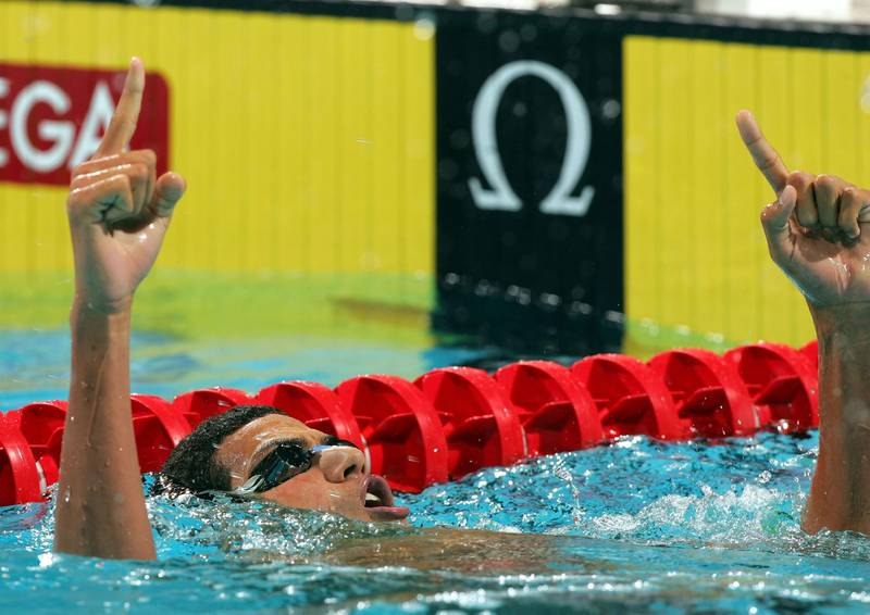 INDIANAPOLIS - OCTOBER 8:  Oussama Mellouli of Tunisia celebrates his gold in the Men's 400 Individual Medley during the FINA World Swimming Championships on October 8, 2004 at the Conseco Fieldhouse in Indianapolis, Indiana.  (Photo by Harry How/Getty Images)