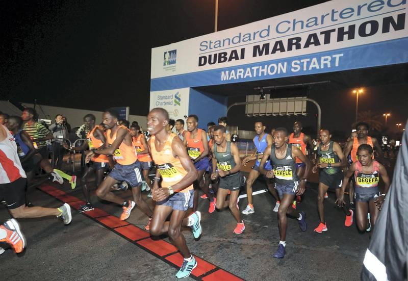 Dubai, United Arab Emirates - January 25, 2019: The elite runners start of the Standard Chartered Dubai Marathon 2019. Friday, January 25th, 2019 at Jumeirah, Dubai. Chris Whiteoak/The National