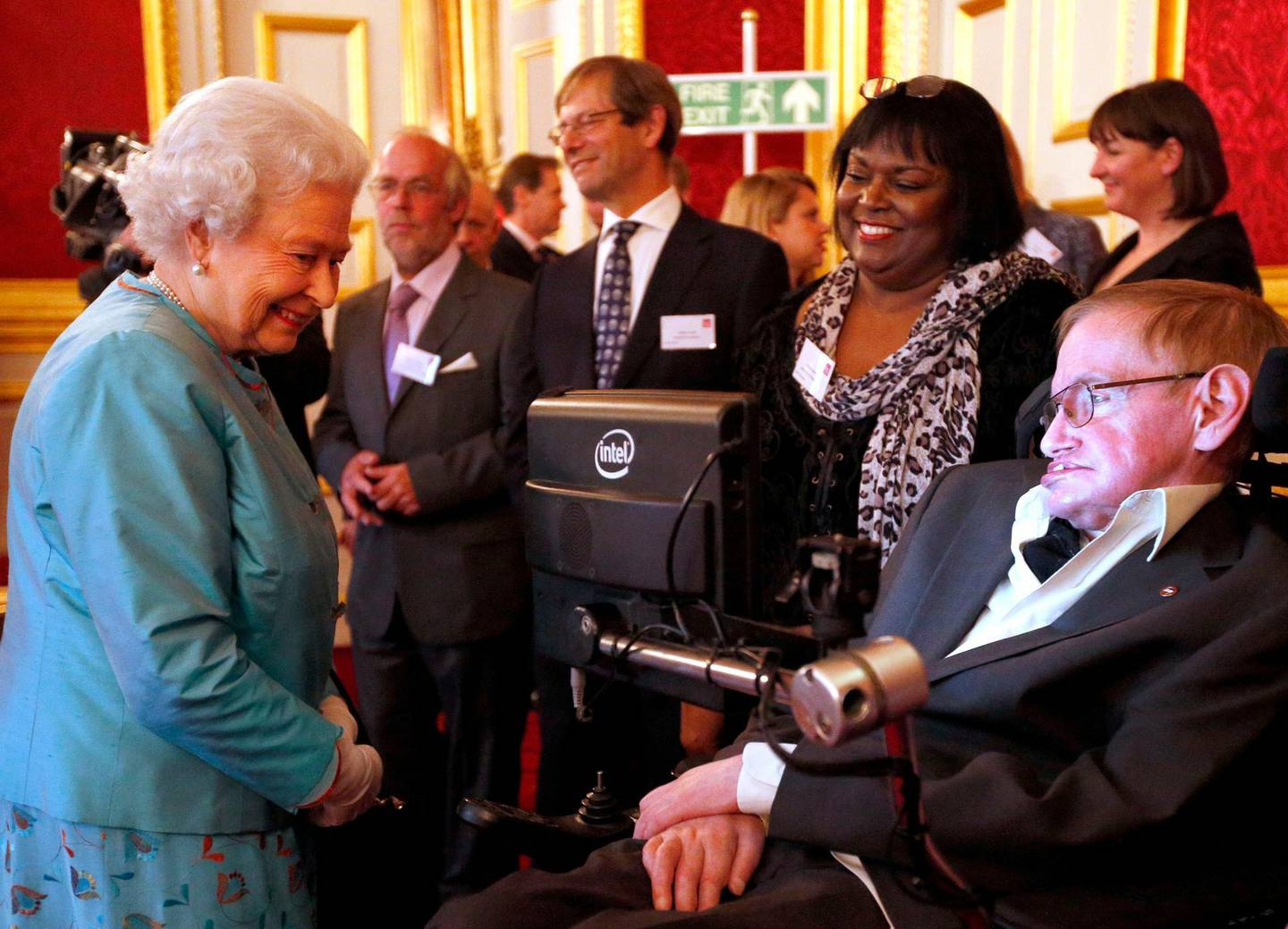 FILE - In this May 29, 2014 file photo, Britain's Queen Elizabeth II meets Professor Stephen Hawking, during a reception for Leonard Cheshire Disability in the State Rooms, St James's Palace, London. Hawking, whose brilliant mind ranged across time and space though his body was paralyzed by disease, has died, a family spokesman said early Wednesday, March 14, 2018. (Jonathan Brady/PA via AP)