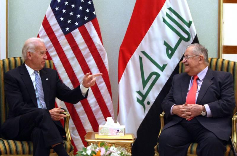 US Vice President Joe Biden gestures during his meeting with Iraqi President Jalal Talabani in Baghdad on January 13, 2011. AFP PHOTO/AHMAD AL-RUBAYE (Photo by AHMAD AL-RUBAYE / AFP)