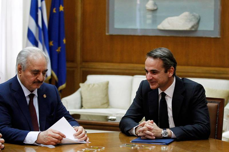 epa08135644 Greek Prime Minister Mitsotakis (R) talks with Commander of the Libyan National Army (LNA) Khalifa Haftar (L) during their meeting in Parliament, in Athens, Greece, 17 January 2020. 'We are pacifists. We have come here to talk about peace,' Libyan National Army Commander Khalifa Haftar said on Friday as he arrived for a meeting with Prime Minister Kyriakos Mitsotakis, at the prime minister's offices in parliament. Earlier, Haftar had a meeting with Greek Foreign Minister Nikos Dendias.  EPA/ALEXANDROS VLACHOS