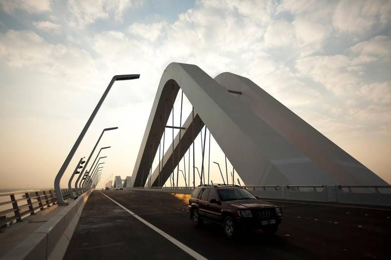 November 28, 2010 - Abu Dhabi, UAE -   Motorists drive across Sheikh Zayed Bridge on Sunday November 28, 2010.  The Sheikh Zayed Bridge in Abu Dhabi is now officially open.  The 842-metre construction, opened by Sheikh Khalifa last night, is the fourth bridge to link Abu Dhabi to the mainland.    (Andrew Henderson/The National)