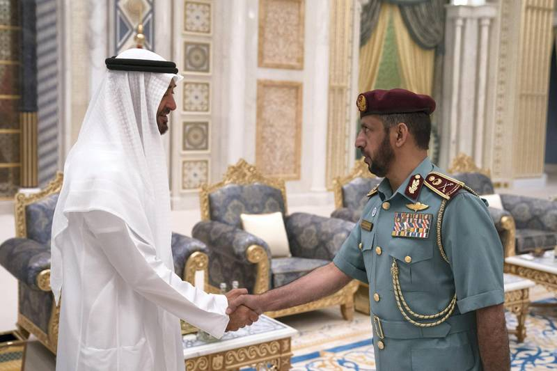 ABU DHABI, UNITED ARAB EMIRATES - May 20, 2018: HH Sheikh Mohamed bin Zayed Al Nahyan Crown Prince of Abu Dhabi Deputy Supreme Commander of the UAE Armed Forces (L), receives a member of the Abu Dhabi Police, during an iftar reception at the Presidential Palace.   ( Hamad Al Kaabi / Crown Prince Court - Abu Dhabi ) ---