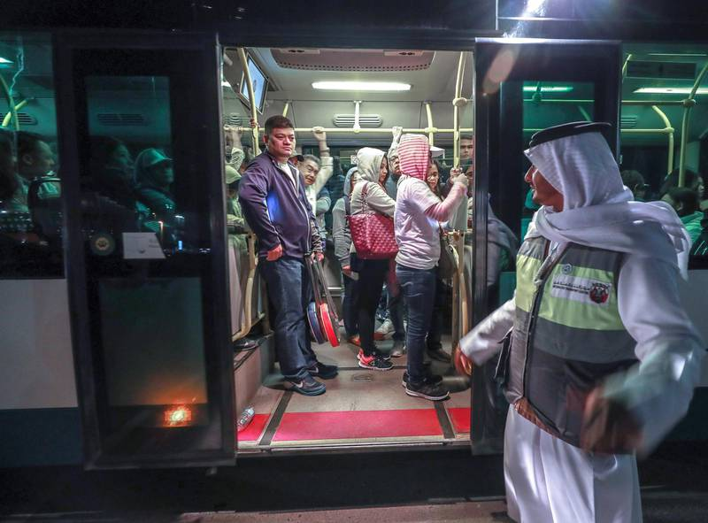 Abu Dhabi, U.A.E., February 5, 2019.   Worshipers heading onto buses at Nation Towers before they're transported to the mass.  RTA employees busy helping worshipers board the shuttles to the mass.Victor Besa/The NationalSection:  NAReporter: