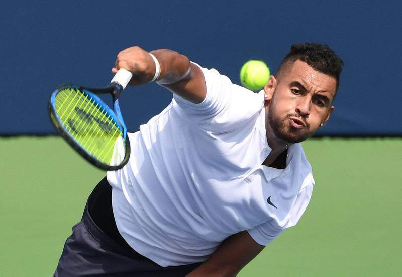 FILE PHOTO:    Aug 7, 2018; Toronto, Ontario, Canada; Nick Kyrgios of Australia plays a shot against Stan Wawrinka of Switzerland (not shown) in the Rogers Cup tennis tournament at Aviva Centre. Mandatory Credit: Dan Hamilton-USA TODAY Sports/File Photo