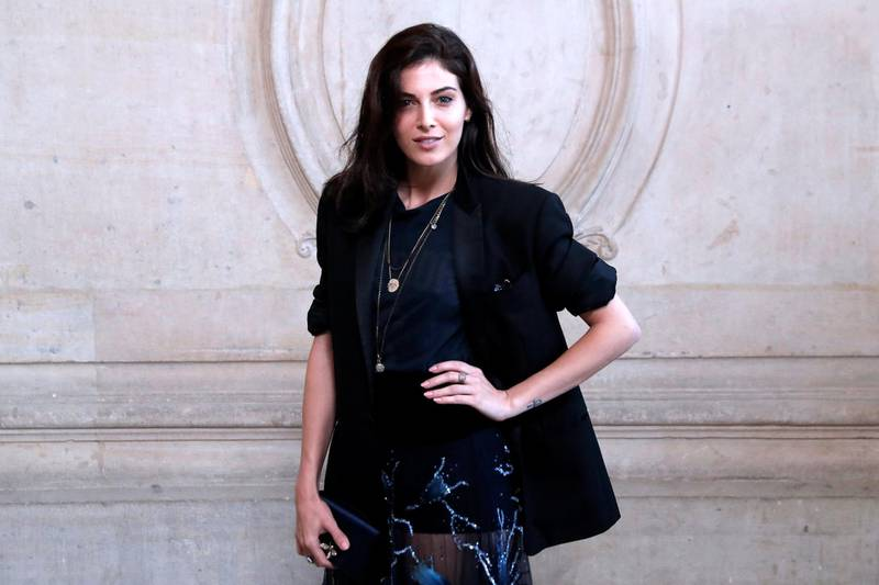 French-Lebanese Razane Jammal poses during a photocall before the Christian Dior women's 2018 Spring/Summer ready-to-wear collection fashion show in Paris, on September 26, 2017. (Photo by Patrick KOVARIK / AFP)