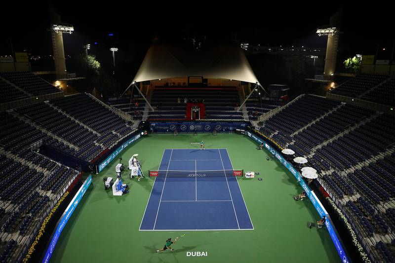 DUBAI, UNITED ARAB EMIRATES - MARCH 20:   Lloyd Harris of South Africa returns the ball during the men's singles Final match against Aslan Karatsev of Russia during day fourteen of the Dubai Duty Free Tennis at Dubai Duty Free Tennis Stadium on March 20, 2021 in Dubai, United Arab Emirates. (Photo by Francois Nel/Getty Images)