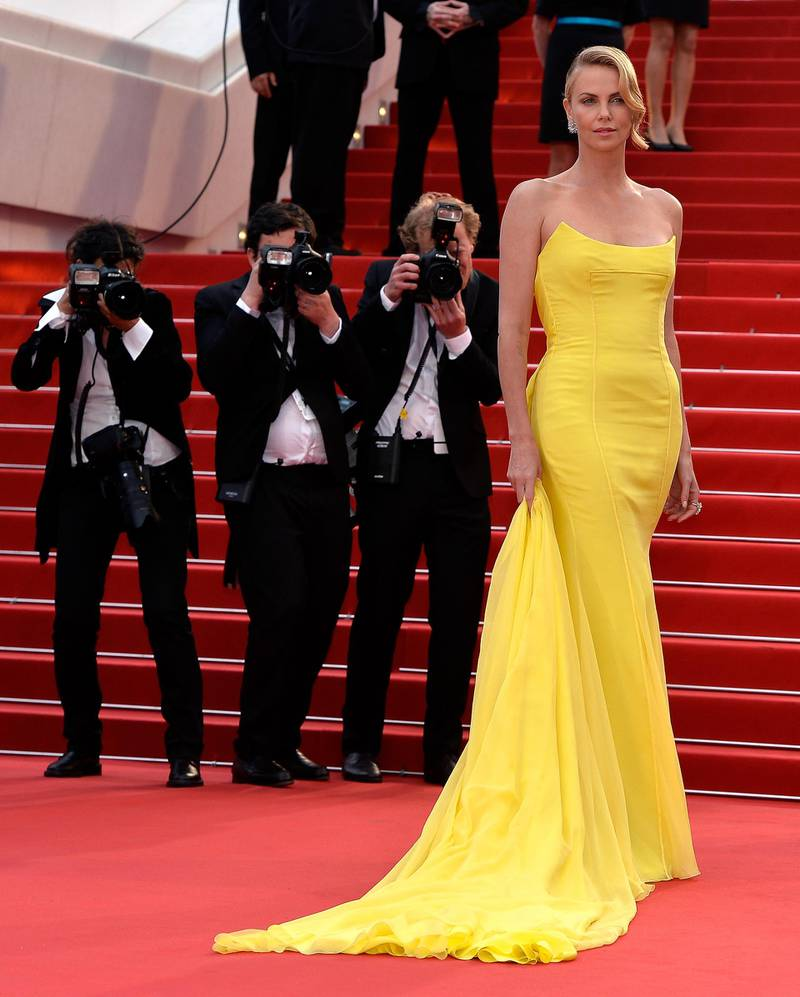 """CANNES, FRANCE - MAY 14: Actress Charlize Theron attends Premiere of """"Mad Max: Fury Road"""" during the 68th annual Cannes Film Festival on May 14, 2015 in Cannes, France.  (Photo by Pascal Le Segretain/Getty Images)"""