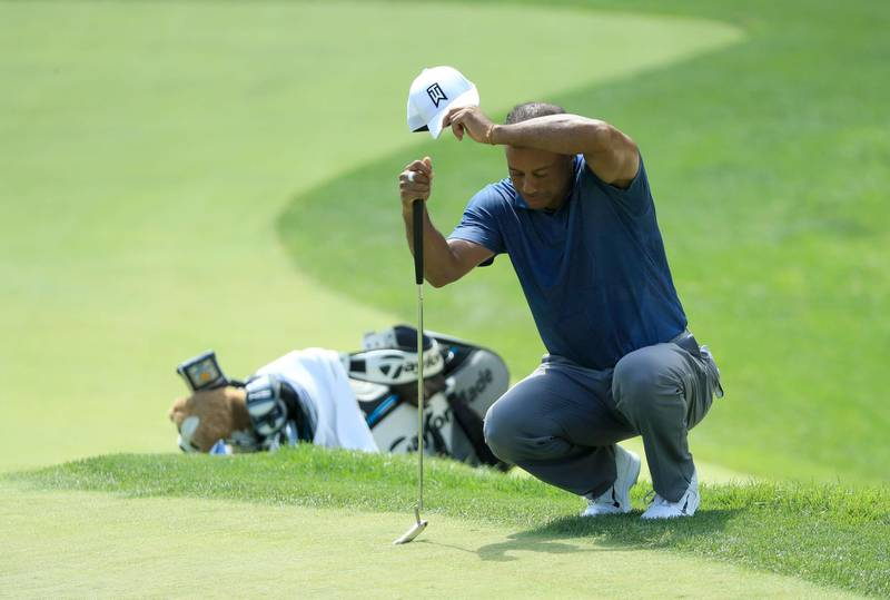 DUBLIN, OHIO - JULY 17: Tiger Woods of the United States wipes his forehead on the fourth green during the second round of The Memorial Tournament on July 17, 2020 at Muirfield Village Golf Club in Dublin, Ohio.   Sam Greenwood/Getty Images/AFP == FOR NEWSPAPERS, INTERNET, TELCOS & TELEVISION USE ONLY ==