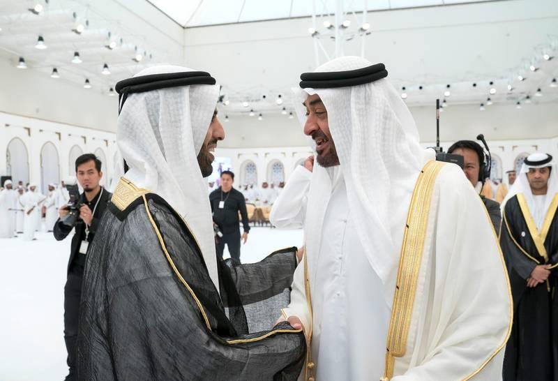 ADHAN, RAS AL KHAIMAH, UNITED ARAB EMIRATES - March 13, 2018: HH Sheikh Mohamed bin Zayed Al Nahyan, Crown Prince of Abu Dhabi and Deputy Supreme Commander of the UAE Armed Forces (R), attends a mass wedding reception for HH Sheikh Mohamed bin Saud bin Saqr Al Qasimi, Crown Prince and Deputy Ruler of Ras Al Khaimah (L), at Mohamed bin Zayed, Al Bayt Mitwahid wedding hall.   ( Mohamed Al Hammadi / Crown Prince Court - Abu Dhabi ) ---
