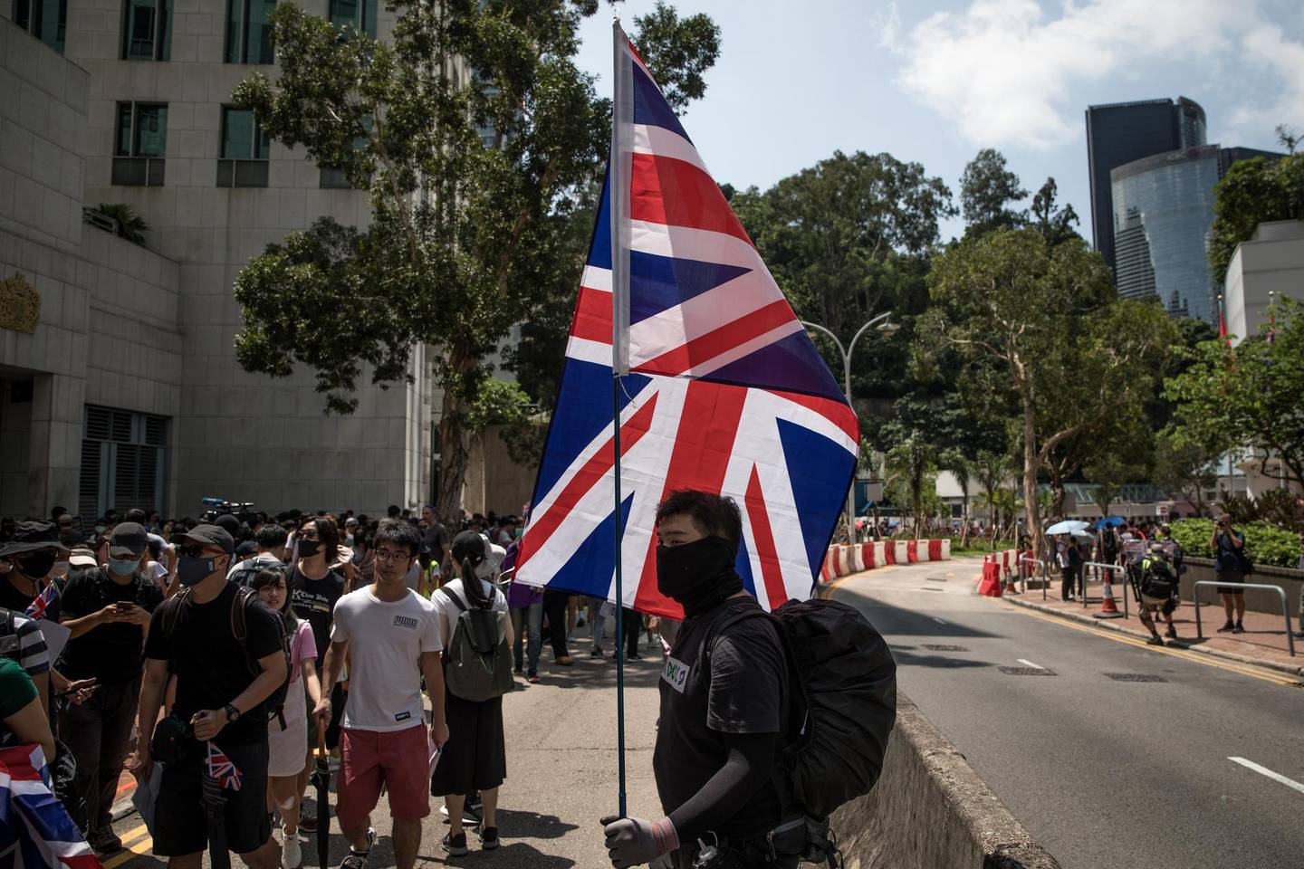 HONG KONG, CHINA - SEPTEMBER 15: Pro-democracy protesters wave  flags and chant slogans outside the UK embassy on September 15, 2019 in Hong Kong, China. Pro-democracy protesters have continued demonstrations across Hong Kong, calling for the city's Chief Executive Carrie Lam to immediately meet the rest of their demands, including an independent inquiry into police brutality, the retraction of the word riot to describe the rallies, and genuine universal suffrage, as the territory faces a leadership crisis. (Photo by Chris McGrath/Getty Images)