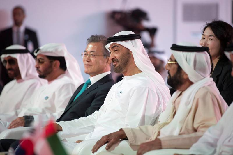 AL DHAFRA, ABU DHABI, UNITED ARAB EMIRATES - March 26, 2018: HH Sheikh Tahnoon bin Mohamed Al Nahyan, Ruler's Representative in Al Ain Region (R), HH Sheikh Mohamed bin Zayed Al Nahyan Crown Prince of Abu Dhabi Deputy Supreme Commander of the UAE Armed Forces (2nd R), HE Moon Jea-In, President of South Korea (3rd R), HH Sheikh Hamdan bin Zayed Al Nahyan, Ruler's Representative in Al Dhafra Region (4th R) and HH Sheikh Nahyan Bin Zayed Al Nahyan, Chairman of the Board of Trustees of Zayed bin Sultan Al Nahyan Charitable and Humanitarian Foundation (L), attend the Unit One Construction Completion Celebration, at Barakah Nuclear Energy Plant.   ( Abdullah Al Junaibi ) ---