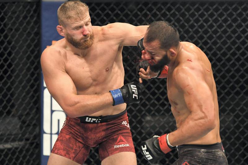 ABU DHABI, UNITED ARAB EMIRATES - SEPTEMBER 27:  (L-R) Jan Blachowicz of Poland punches Dominick Reyes in their light heavyweight championship bout during UFC 253 inside Flash Forum on UFC Fight Island on September 27, 2020 in Abu Dhabi, United Arab Emirates. (Photo by Josh Hedges/Zuffa LLC)