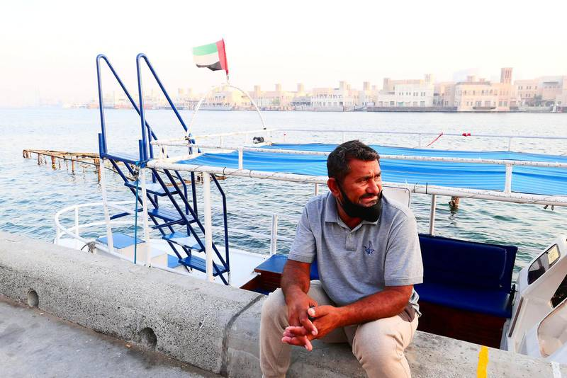 Mohammed Akram waiting for the customers near his boat at the creek in Deira Dubai during the evening on April 21, 2021. Pawan Singh / The National. Story by Sarwat Nasir