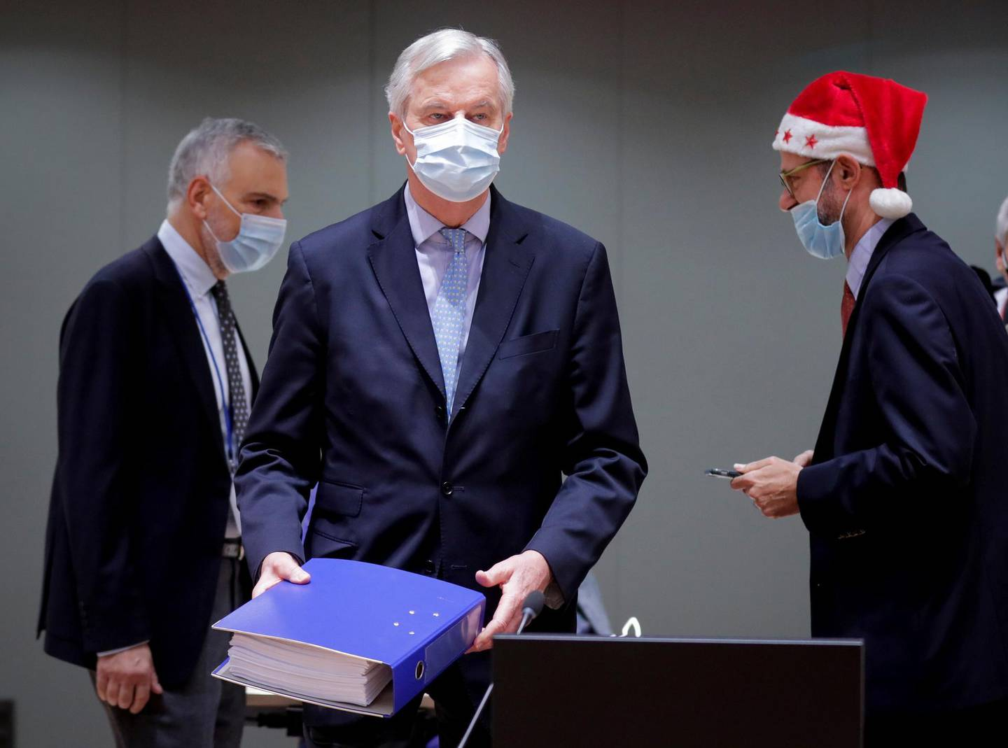 European Union's chief Brexit negotiator Michel Barnier holds the pages of Brexit trade deal as he attends a meeting of the Committee of the Permanent Representatives of the Governments of the Member States to the European Union (COREPER) in Brussels, Belgium December 25, 2020. Olivier Hoslet/Pool via REUTERS     TPX IMAGES OF THE DAY