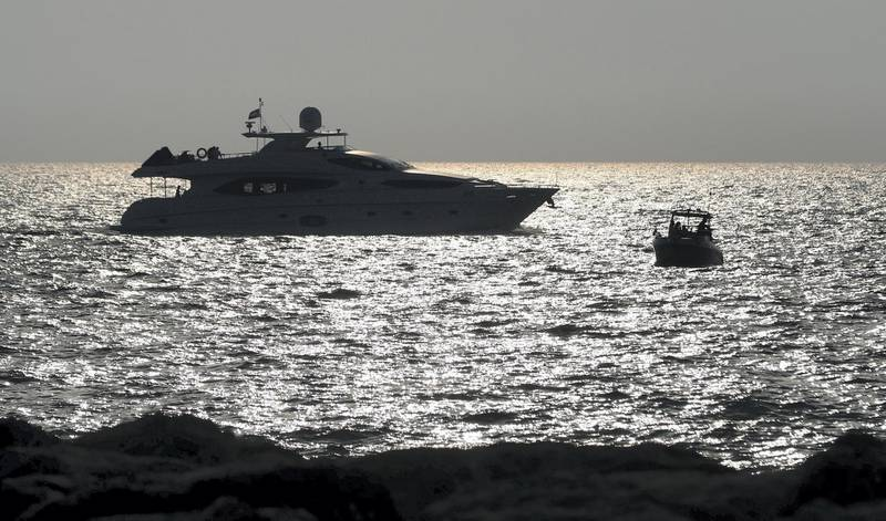 Dubai, United Arab Emirates - Reporter: N/A. News. The sun sets on a yacht on the longest day of the year. Sunday, June 21st, 2020. Dubai. Chris Whiteoak / The National
