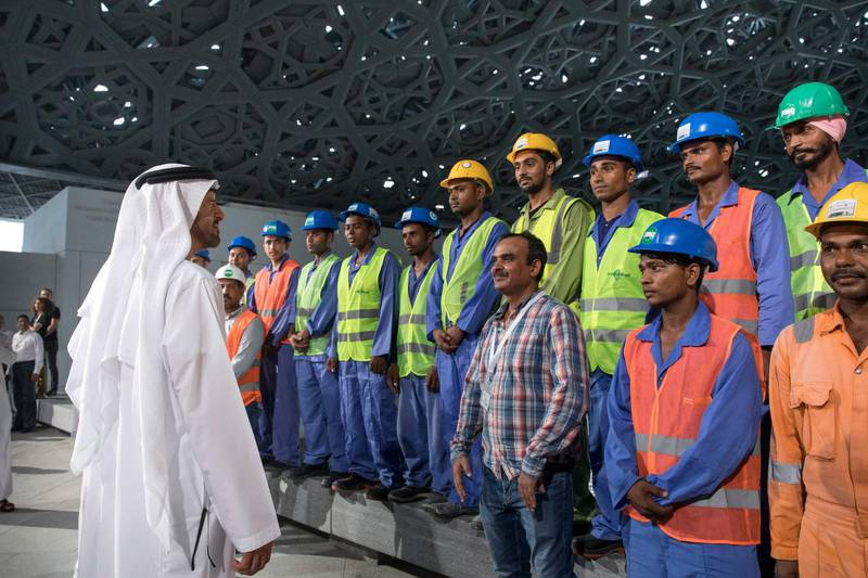 SAADIYAT ISLAND, ABU DHABI, UNITED ARAB EMIRATES - September 11, 2017: HH Sheikh Mohamed bin Zayed Al Nahyan, Crown Prince of Abu Dhabi and Deputy Supreme Commander of the UAE Armed Forces (L), speaks with construction workers while touring the newly constructed Louvre Abu Dhabi.  ( Ryan Carter / Crown Prince Court - Abu Dhabi ) ---
