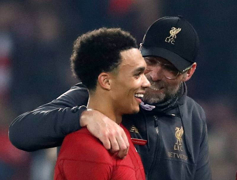 """Soccer Football - Premier League - Liverpool v Watford - Anfield, Liverpool, Britain - February 27, 2019  Liverpool manager Juergen Klopp and Liverpool's Trent Alexander-Arnold celebrate after the match          Action Images via Reuters/Carl Recine  EDITORIAL USE ONLY. No use with unauthorized audio, video, data, fixture lists, club/league logos or """"live"""" services. Online in-match use limited to 75 images, no video emulation. No use in betting, games or single club/league/player publications.  Please contact your account representative for further details."""