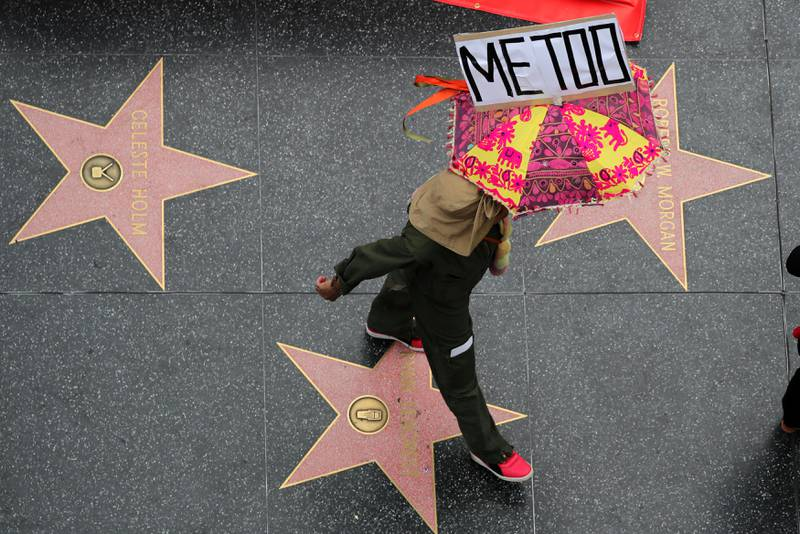 A demonstrator takes part in a #MeToo protest march for survivors of sexual assault and their supporters in Hollywood, Los Angeles, California U.S. November 12, 2017. REUTERS/Lucy Nicholson