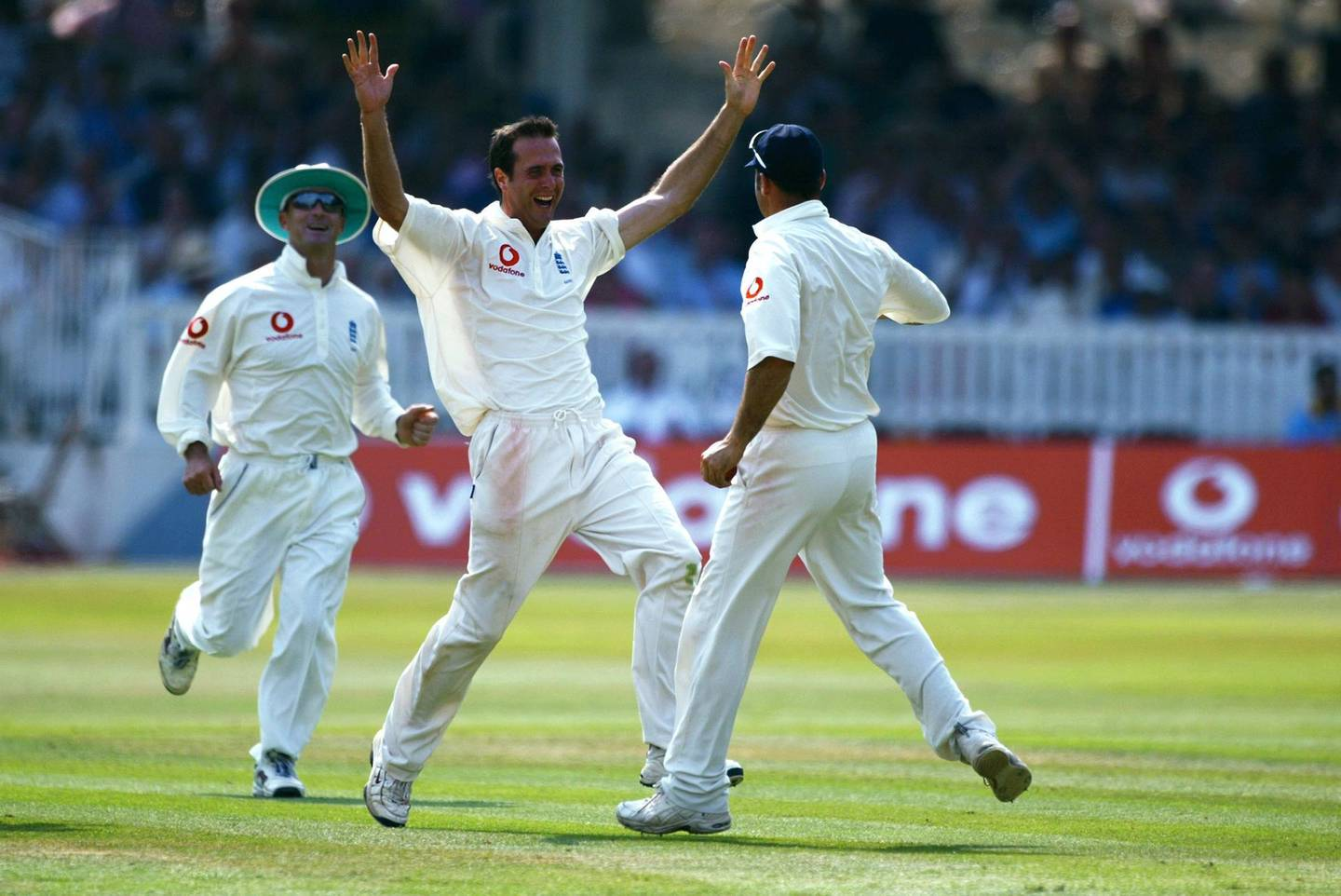 LONDON - JULY 28 :  Michael Vaughan and Nasser Hussain of England celebrate Vaughan's first test wicket during the fourth day of the first npower test match between England and India at Lords in London on July 28, 2002. (Photo By Ben Radford/Getty Images) England won the test match by 170 runs.