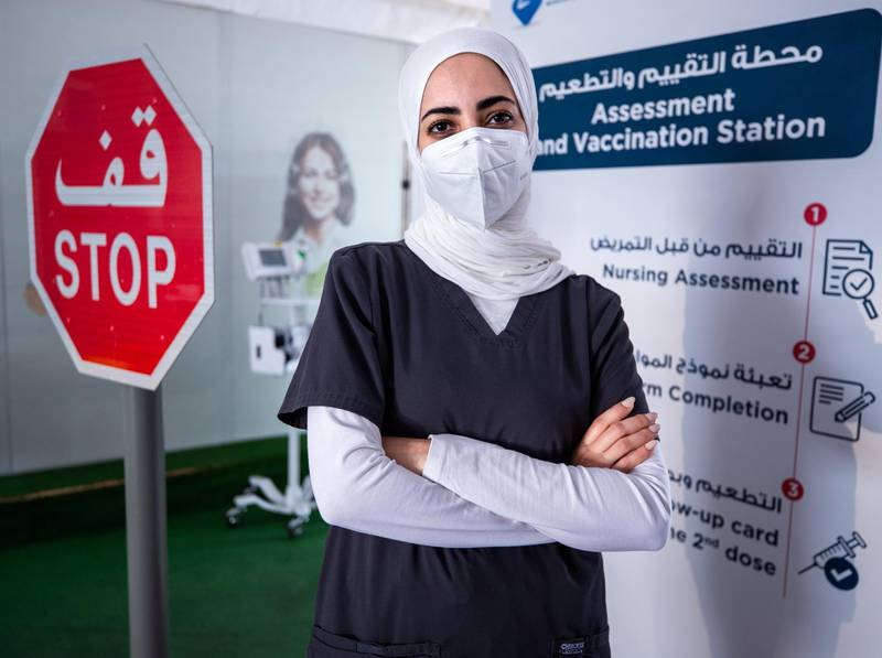 Mariam AlBadi an Emirati nurse at the  SEHA Covid-19 Drive-Through Service Center at the Corniche in Abu Dhabi on June 17th, 2021.  There is a huge demand for vaccinations and PCRs after the green pass restrictions. Victor Besa / The National.Reporter: Shireena Al Nowais for News