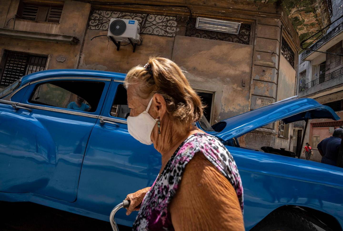 A woman, wearing a protective face mask as a precaution against the spread of the new coronavirus, walks past in Havana, Cuba, Wednesday, June 1 , 2021. (AP Photo/Ramon Espinosa)