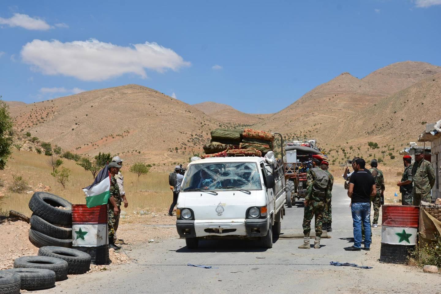 epa06906590 A handout photo made available by the Syrian Arab News Agency (SANA) shows hundreds of Syrian refugees returning from the Lebanese territories through al-Zamrani corridor to their homes in al-Qalamoun area in Damascus countryside, Syria, 23 July 2018. According to media reports, Lebanon hosts 1,011,366 Syrian refugees registered with UNHCR, Including 80 thousand refugees living in seven camps in the city of Arsal. Some 900 displaced Syrians would return. this is the third batch of displaced Syrians, who have recently returned to their homeland.  EPA/SANA HANDOUT  HANDOUT EDITORIAL USE ONLY/NO SALES