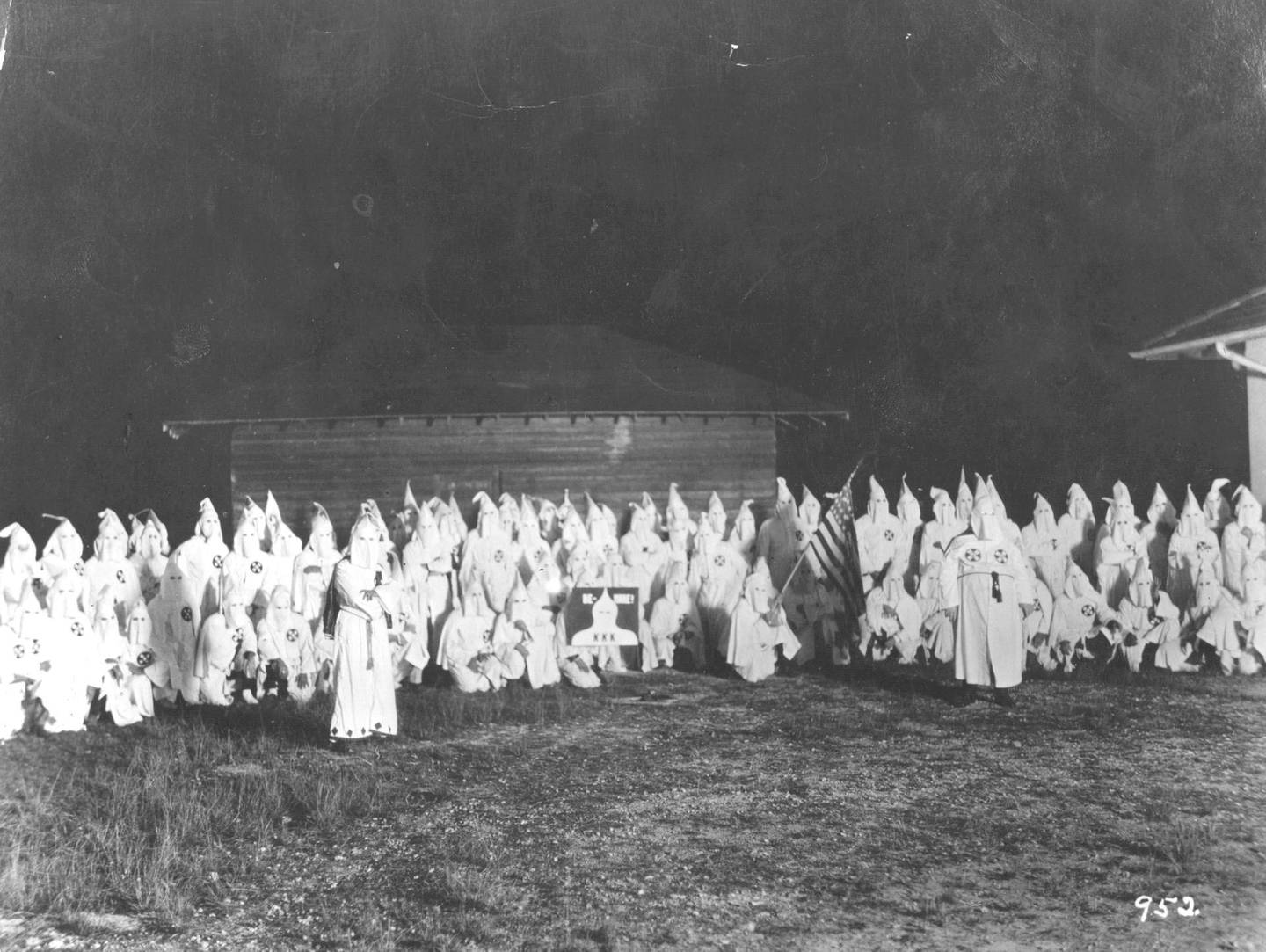 circa 1920:  A meeting of the hooded members of the American white supremecist movement, the Ku Klux Klan (KKK).  (Photo by Hulton Archive/Getty Images)