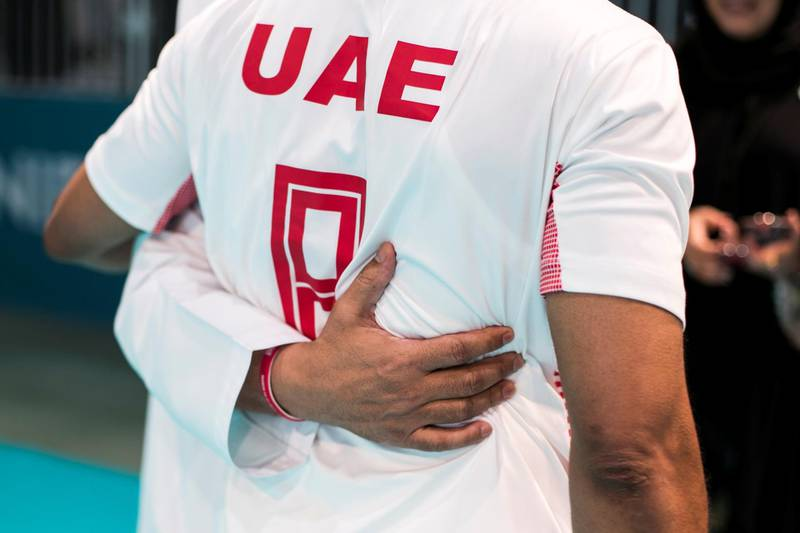 ABU DHABI, UNITED ARAB EMIRATES - March 20 2019.UAE's handball team embrace as they celebrates their win agains Russia at the Special Olympics World Games in ADNEC. (Photo by Reem Mohammed/The National)Reporter: Section:  NA