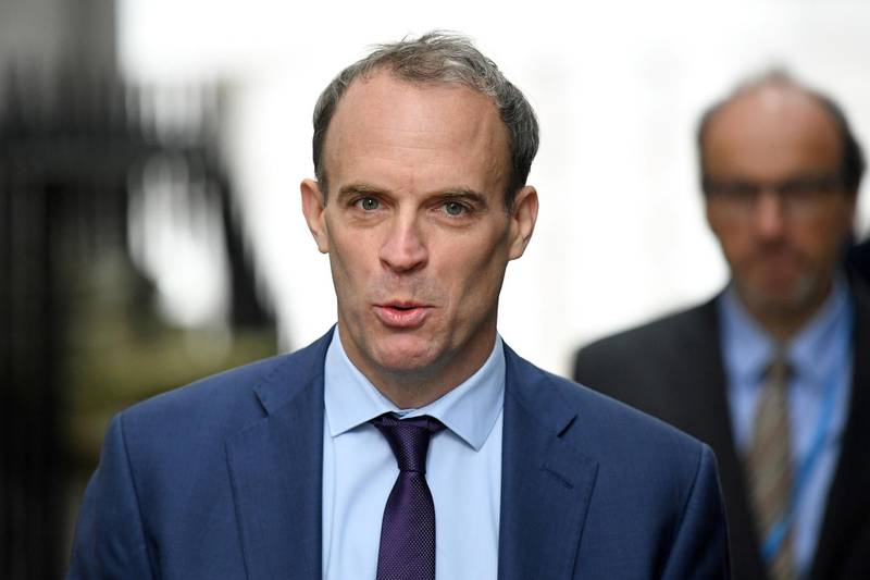 Britain's Foreign Secretary Dominic Raab reacts as he arrives in Downing Street in central London on October 6, 2020. British Prime Minister Boris Johnson will seek to banish the coronavirus gloom with a vision of a prosperous future fuelled by floating windmills when he addresses his Conservative party's annual conference Tuesday. In a speech closing the four-day digital event, he will highlight an election pledge to quadruple the power generated by offshore wind from 10 to 40 gigawatts this decade, saying it would support 60,000 new jobs. / AFP / Daniel LEAL-OLIVAS