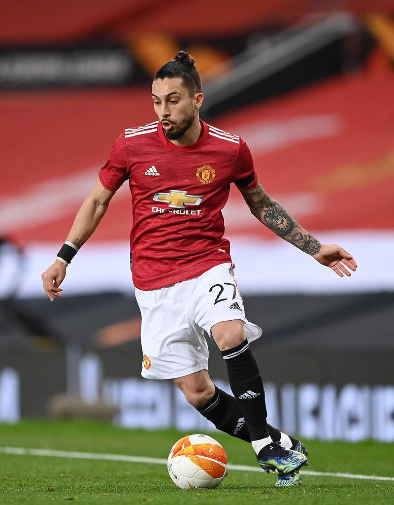 MANCHESTER, ENGLAND - FEBRUARY 25: Alex Telles of Manchester United runs with the ball during the UEFA Europa League Round of 32 match between Manchester United and Real Sociedad at  on February 25, 2021 in Manchester, England. Sporting stadiums around the UK remain under strict restrictions due to the Coronavirus Pandemic as Government social distancing laws prohibit fans inside venues resulting in games being played behind closed doors. (Photo by Laurence Griffiths/Getty Images)
