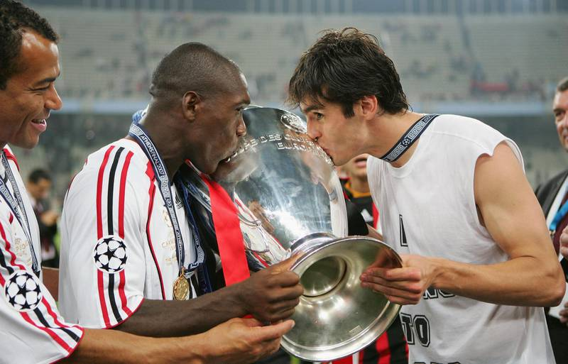 ATHENS, GREECE - MAY 23:  (L to R) Milan teammates Clarence Seedorf and Kaka kiss the trophy following their teams 2-1 victory during the UEFA Champions League Final match between Liverpool and AC Milan at the Olympic Stadium on May 23, 2007 in Athens, Greece.  (Photo by Jamie McDonald/Getty Images)