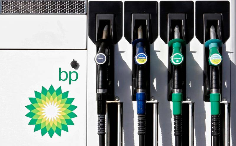 FILE - In this file photo dated Tuesday, Aug. 1, 2017, a car fuel pump at a BP petrol station in London.  Oil producer BP released second-quarter 2020 earnings figures Tuesday Aug. 4, 2020, saying it plans to slash dividends as the global oil company prepares for declining sales of fossil fuels. (AP Photo/Caroline Spiezio, FILE)