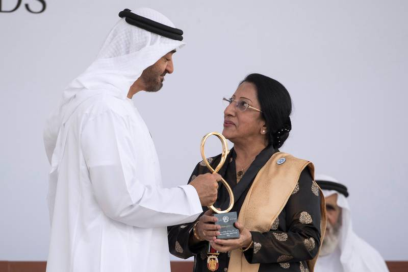 ABU DHABI, UNITED ARAB EMIRATES -  March 12, 2018: HH Sheikh Mohamed bin Zayed Al Nahyan, Crown Prince of Abu Dhabi and Deputy Supreme Commander of the UAE Armed Forces (L), presents an Abu Dhabi Award to Dr Jayanti Maitra (R), during the awards ceremony at the Sea Palace. ( Ryan Carter for the Crown Prince Court - Abu Dhabi ) ---