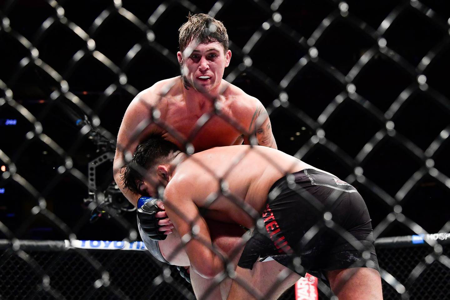 NEW YORK, NEW YORK - NOVEMBER 02: Kelvin Gastelum of the United States (R) fights against Darren Till of the United Kingdom in the Middleweight bout during UFC 244 at Madison Square Garden on November 02, 2019 in New York City.   Steven Ryan/Getty Images/AFP