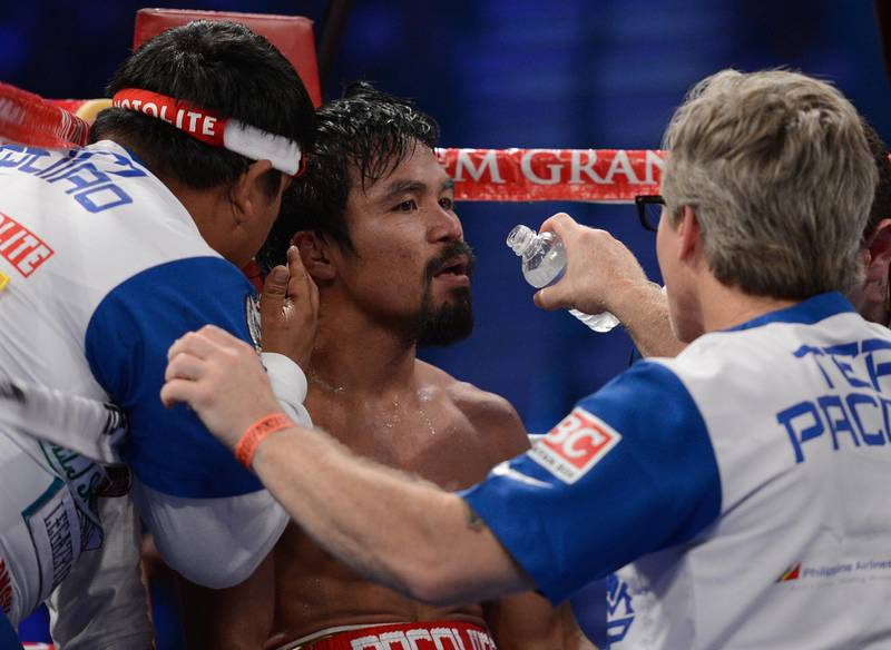 LAS VEGAS, NV - JUNE 09:  (R-L) Trainer Freddie Roach gives Manny Pacquiao instruction between rounds during his bout against Timothy Bradley at MGM Grand Garden Arena on June 9, 2012 in Las Vegas, Nevada.  (Photo by Kevork Djansezian/Getty Images)