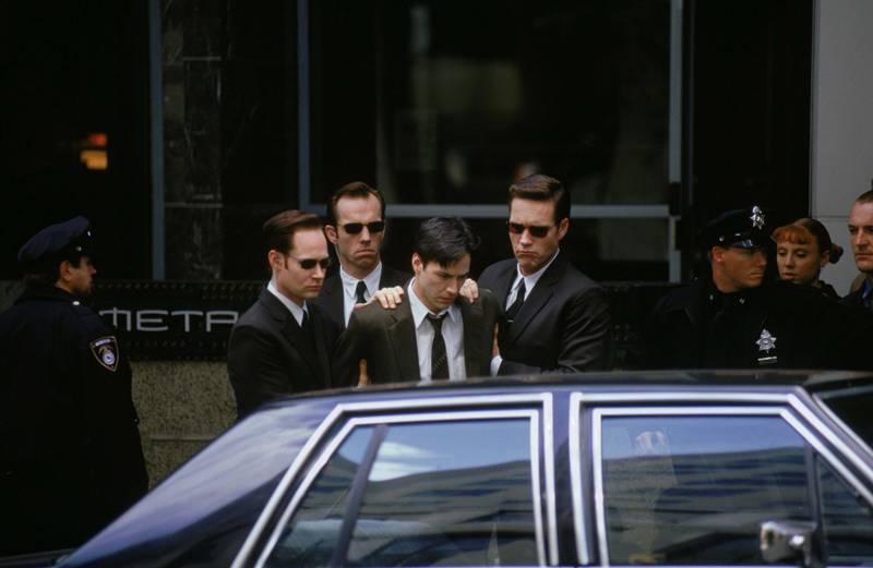 Keanu Reeves, Hugo Weaving, Robert Taylor & Paul Goddard in The Matrix. Courtesy Warner Bros.