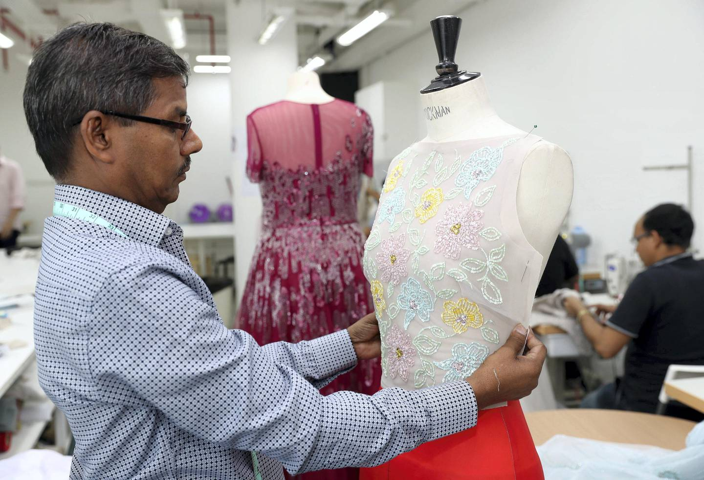 Dubai, United Arab Emirates - August 23rd, 2017: A feature on fashion designer Rami Al Ali & Karashash Nurakhmet a ESMOD fashion school intern. Karashash is designing clothes which will then be sold, and Rami Al Ali is helping lend his industry knowledge. Wednesday, August 23rd, 2017 at The Design District, Dubai. Chris Whiteoak / The National