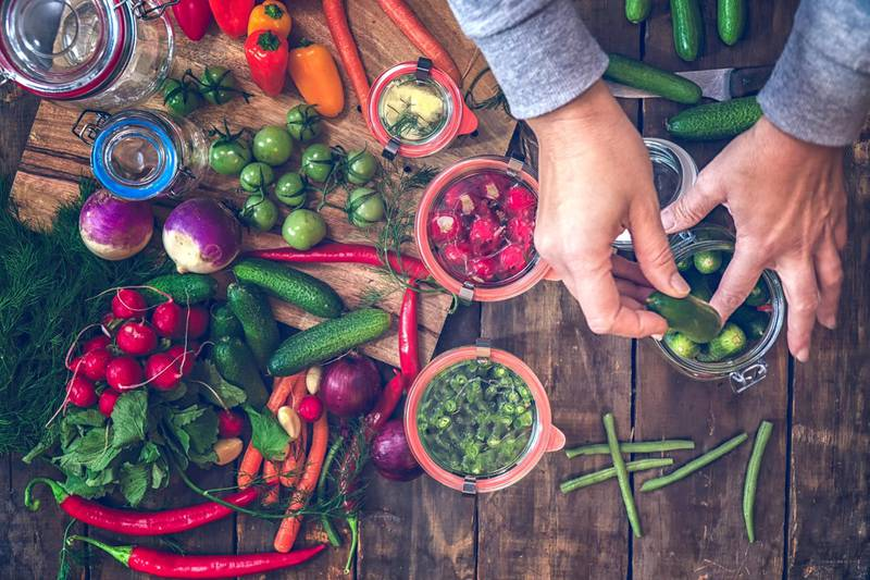 Preserving organic vegetables in jars like carrots, cucumbers, tomatoes, chilis, paprika and radishes. Getty Images