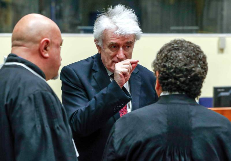 epa06686668 Former Bosnian Serb leader Radovan Karadzic appears in a courtroom before the International Residual Mechanism for Criminal Tribunals (MICT), which is handling outstanding war crimes cases for the Balkans and Rwanda, in The Hague, Netherlands, 23 April 2018.  Former Bosnian Serb leader Karadzic appeals against his conviction for genocide and a 40-year prison sentence. Karadzic was convicted in 2016 for war crimes committed, including the 1995 Srebrenica massacre.  EPA-EFE/Yves Herman / POOL *** Local Caption *** 54282807