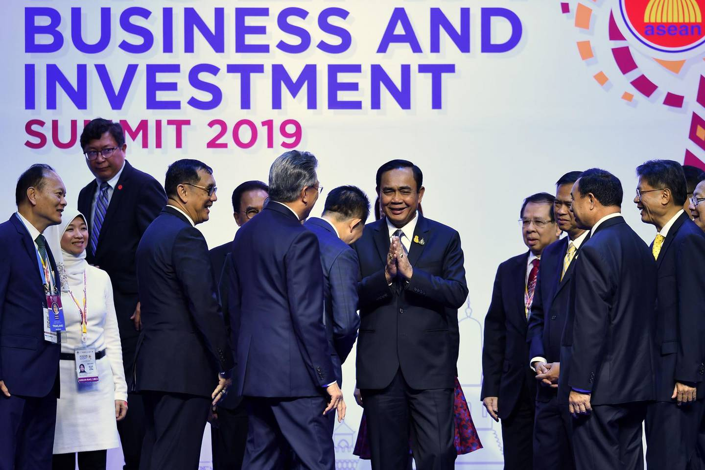Thailand prime minister Prayut Chan-O-Cha (C) greets distinguished guests at a business forum on the sidelines of the 35th Association of Southeast Asian Nations (ASEAN) summit in Bangkok on November 2, 2019. / AFP / Lillian SUWANRUMPHA