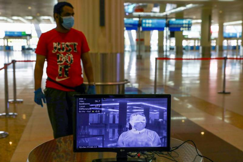 A man is seen through a thermal camera at Dubai International Airport, as Emirates airline resumed limited outbound passenger flights amid the outbreak of the coronavirus disease (COVID-19) in Dubai, UAE April 27, 2020. REUTERS/Ahmed Jadallah
