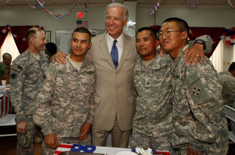 BAGHDAD, IRAQ - JULY 4:  U.S. Vice President Joe Biden (C) poses with soldiers for a photo at Camp Victory on July 4, 2009 near Baghdad, Iraq. Bidden's first visit to Iraq as the Vice President comes days after U.S. forces pulled out from Iraq's cities. (Photo by Khalid Mohammed-Pool/Getty Images)
