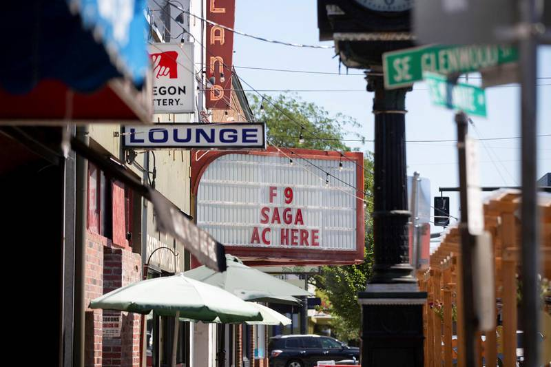 A movie theatre advertises air conditioning along with a movie during unprecedented heat wave in Portland, Oregon, U.S. June 27, 2021. REUTERS/Maranie Staab