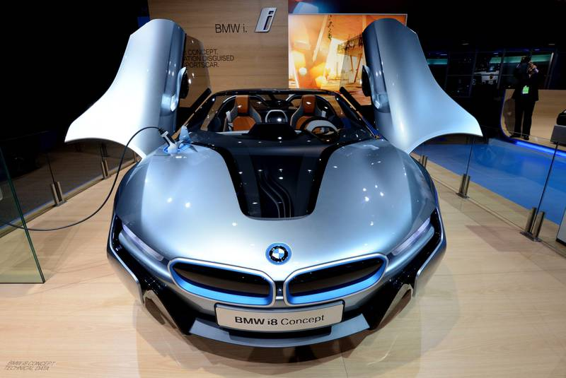 The BMW I8 electric concept sportscar on display with its side doors open at the 2013 North American International Auto Show in Detroit, Michigan, January 15, 2013. AFP PHOTO/Stan HONDA  *** Local Caption ***  266857-01-08.jpg