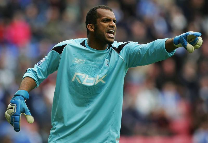 WIGAN, UNITED KINGDOM - MARCH 16:  Ali Al Habsi of Bolton Wanderers in action during the Premier League match between Wigan Athletic and Bolton Wanderers at the JJb Stadium on March 16, 2008 in Wigan, England.  (Photo by Matthew Lewis/Getty Images)