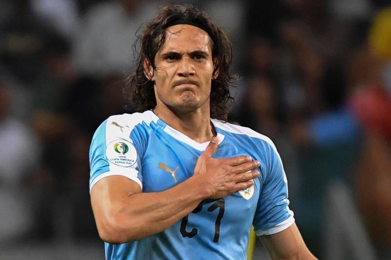 (FILES) In this file photo taken on June 16, 2019, Uruguay's Edinson Cavani celebrates after scoring against Ecuador during their Copa America football tournament group match at the Mineirao Stadium in Belo Horizonte, Brazil. Former Paris Saint-Germain striker Edinson Cavani has been dropped from the Uruguay squad named on October 2, 2020 for the upcoming World Cup qualifiers against Chile and Ecuador. / AFP / Luis ACOSTA
