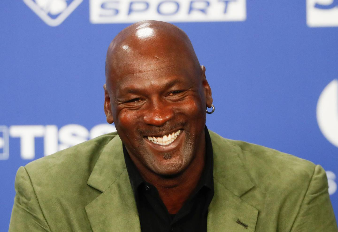 FILE - Basketball legend Michael Jordan speaks during a press conference ahead of an NBA basketball game between the Charlotte Hornets and Milwaukee Bucks in Paris, in this Friday, Jan. 24, 2020, file photo. Jordan is donating $10 million to launch two medical clinics in underserved communities near his hometown in North Carolina, a regional health care system announced Monday, Feb. 15 2021. (AP Photo/Thibault Camus, File)