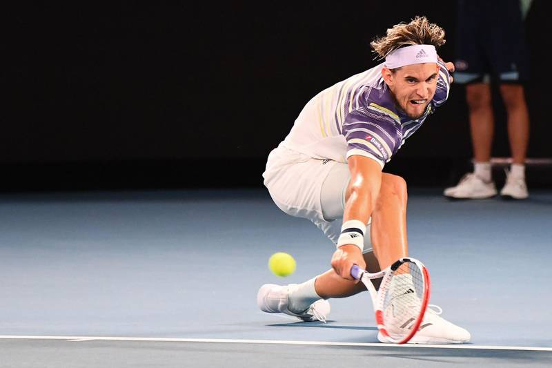 Austria's Dominic Thiem hits a return against Germany's Alexander Zverev during their men's singles semi-final match on day twelve of the Australian Open tennis tournament in Melbourne on January 31, 2020. IMAGE RESTRICTED TO EDITORIAL USE - STRICTLY NO COMMERCIAL USE  / AFP / William WEST / IMAGE RESTRICTED TO EDITORIAL USE - STRICTLY NO COMMERCIAL USE
